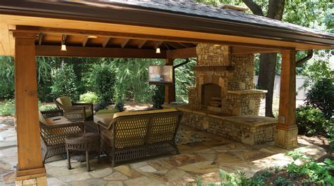 Outdoor Living Room With Tv Circle Side Table Stone Tile