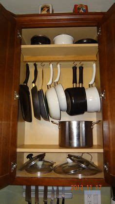 organizing pots and pans in kitchen cabinets files organized kitchen cabinet kitchen 9673