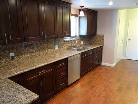 granite countertops with brown cabinets grey granite countertops with brown cabinets images home