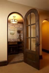 Rustic Basement Bar by Wine Cellar Doors Wine Cellar Rustic With Arched Door