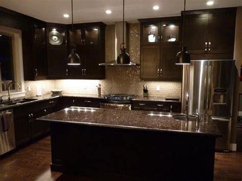black kitchen island with stainless steel top kitchens with black cabinets black glass tile backsplash