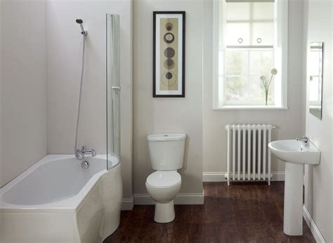 small bathroom picture low white acrylic tub with white polished wooden vanity cabinet in white ceramic bathroom wall