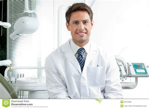 happy dentist in clinic royalty free stock image