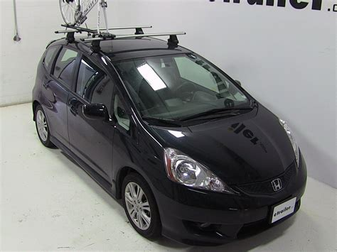 This basic strap style bike rack is a work horse carrying a wide variety of bikes and is simple and easy to use. 2012 Honda Fit Rhino-Rack MountainTrail Rooftop Bike ...