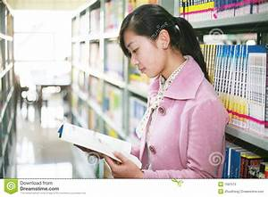 Young Woman Reading In Library Stock Photos - Image: 7587513
