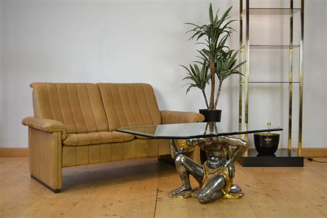 However, as time passes it became easier to construct these tables and so they were sold at good prices that have been cost effective for most. Moor Coffee Table , Wood Sculpture Crystal Glass Top, Mid-Century | Retro Station