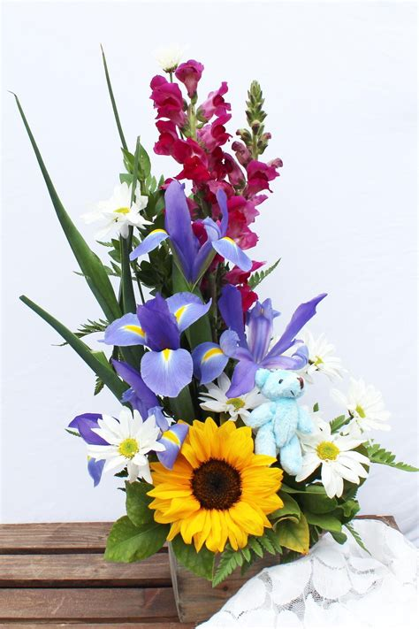 A bright and cheery arrangement with Snap Dragons Iris
