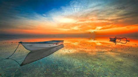 indonesia landscape sunset beach lake boat orange sky