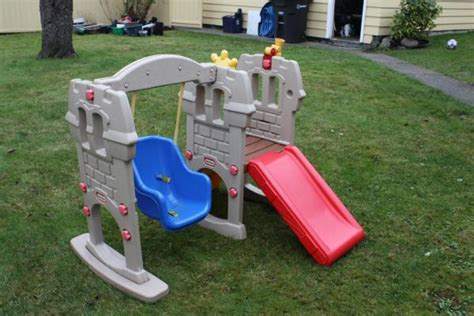 tike swing and slide tikes swing along slide castle play set climber