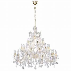 Very large gold crystal chandelier hanging on chain