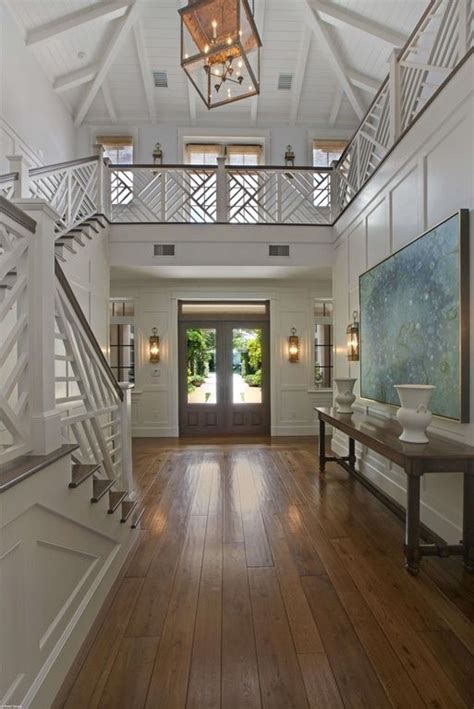 open entryway  wainscoting  unique staircase
