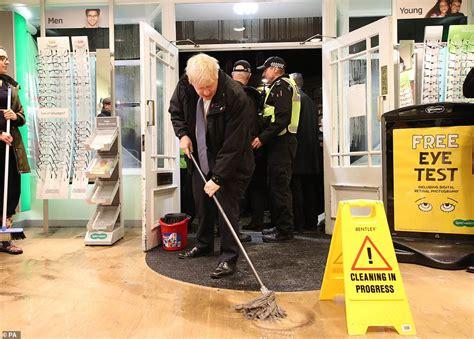 prime minister boris johnson arrives  flood hit
