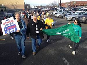 Dozens protest Walmart worker's firing as company changes ...