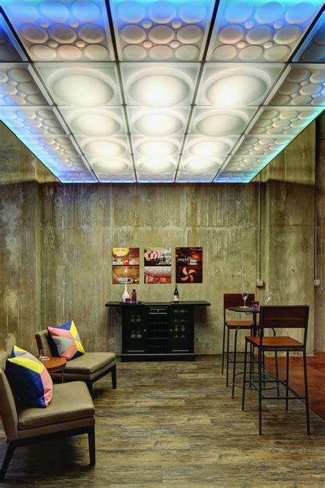 drop  ceiling panels installed beneath fire sprinklers