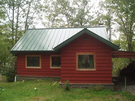 green metal roof house search house exterior
