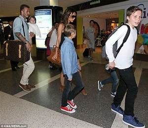 Brooklyn Beckham holds mother Victoria's hand as the ...