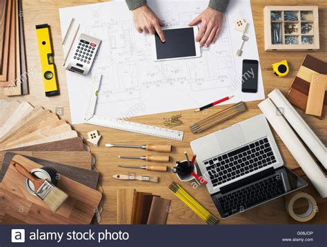 Construction Engineer And Architect's Desk With House