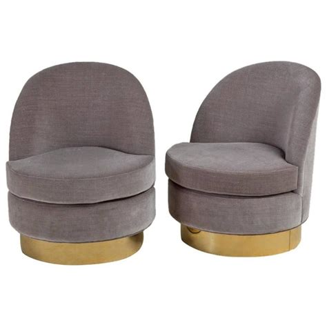 standard pair of swivel chairs on brass bases by talisman