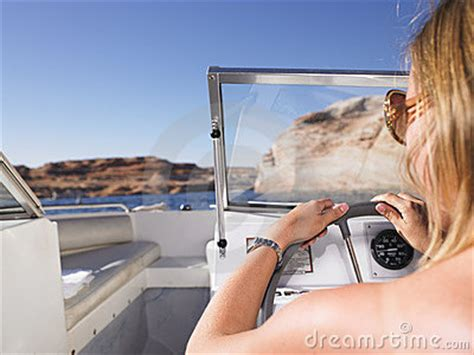 woman driving boat stock  image