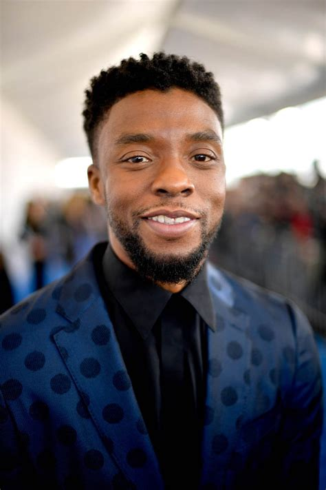 Black panther star dies of cancer aged 43. Chadwick Boseman in blue at the Independent Spirit Awards