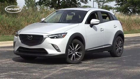 who makes mazda cars cupholder or armrest the mazda cx 3 makes you choose