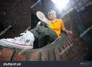 Teenage Hip-Hop Girl On Urban City Wall Of Red Brick Stock ...