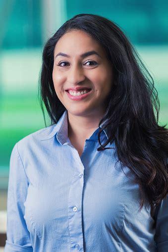 Professional Headshot Of Mid Adult Hispanic Businesswoman ...