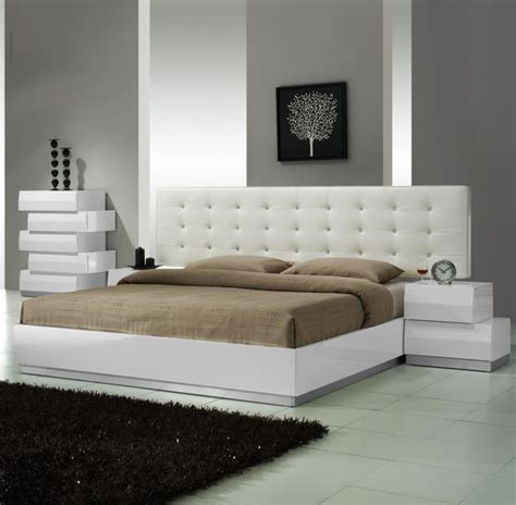 white modern platform bed with leather headboard