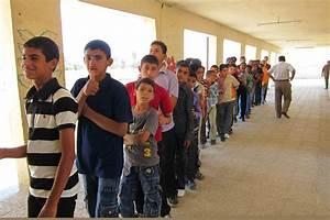 File:Iraqi school children stand in line to receive school ...