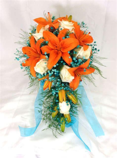 fall wedding cascade style brides bouquet orange