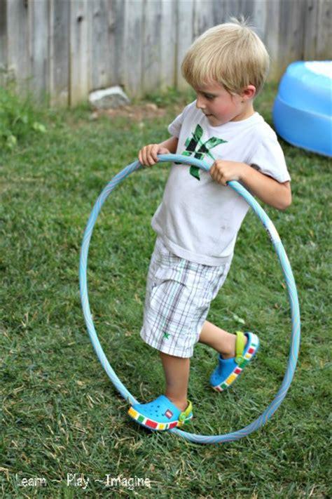 gross motor activity hula hoop learn play imagine 490 | Gross Motor Activity %7BHula Hoop Games%7D (41)