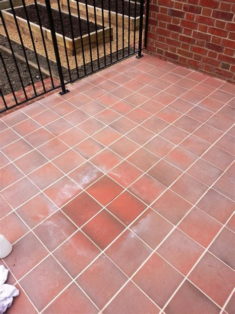 Removing Grout From Porcelain Tile by Newly Laid Quarry Tiled Terrace Treated For Grout In