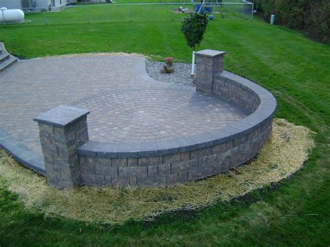 patio paver edging earth tone paver patio with sitting wall and rock fill