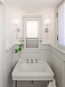 Small Powder Bathroom Ideas Bathrooms Chrome Sconces Fixtures Gray Wainscoting Gray Pedestal Sink Gray Medicine Cabinet