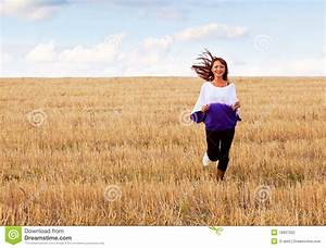 A Woman Is Running Through The Field Stock Photography ...