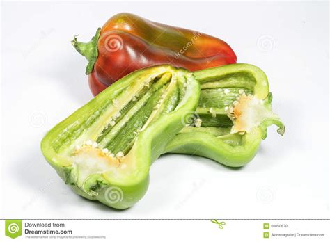 vegetables cut in half seeds of green pepper cut in half on white stock photo image 60850670