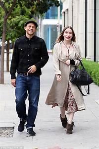 Charlie Hunnam and Morgana McNelis smile away as they go ...