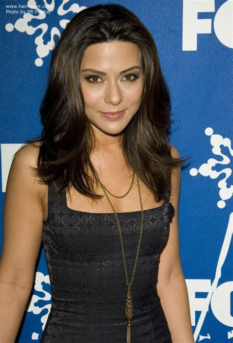 Marisol Nichols wearing her long hair with a lot of volume