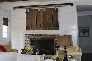 stylish ways to hide your tv hide tv sliding barn doors With barn doors to hide tv