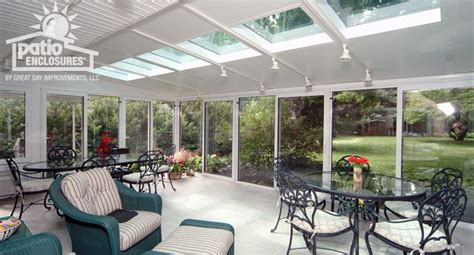 white aluminum frame all season room with glass roof panels decks swings outdoor rooms