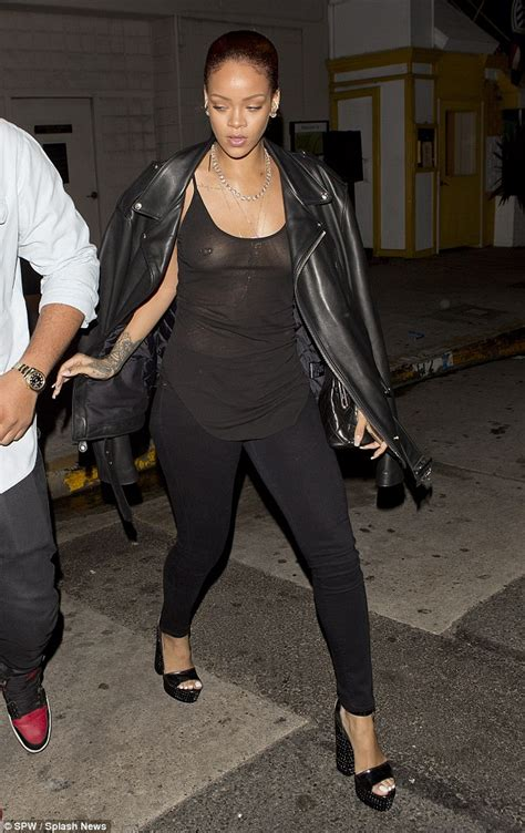 Rihanna goes braless again in see-through vest top | Daily ...