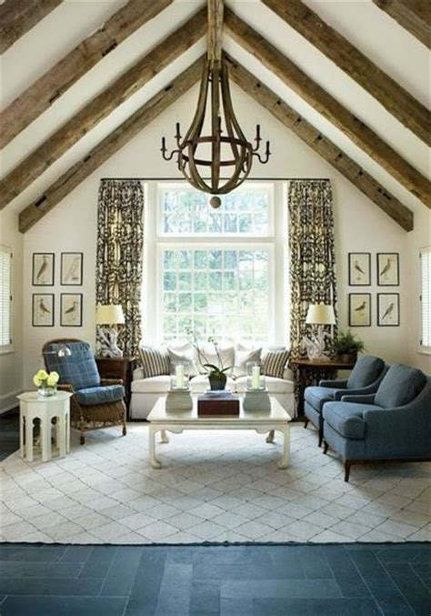 wine barrel chandelier and vaulted ceilings inside a