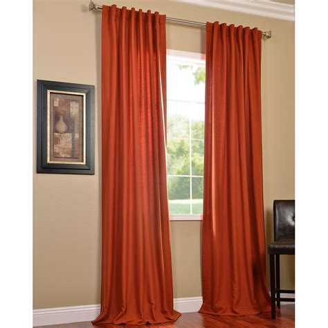 contemporary living room with burnt orange curtains panels