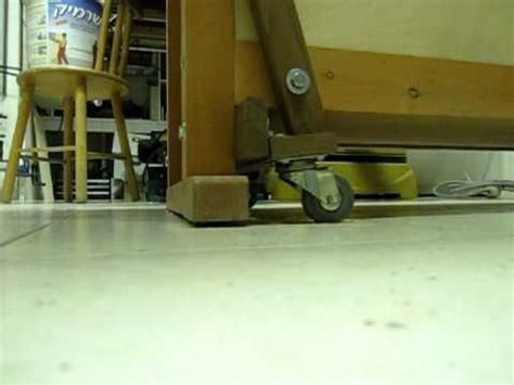 simple  profile workbench wheels lift mechanism