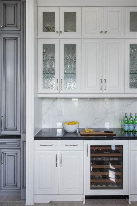 Ideas For Glass Kitchen Cabinets by Chic Kitchen Bar Boasts White Cabinets Fitted With Leaded