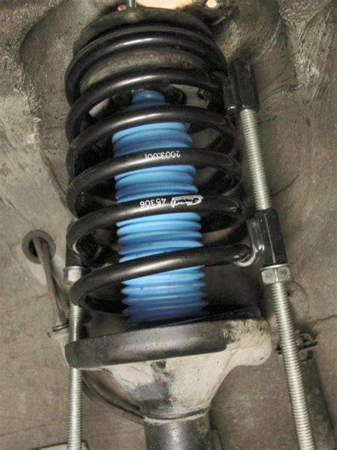 bmw   series front shock  spring replacement