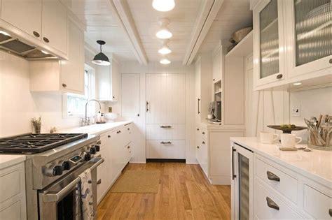 galley kitchen lighting ideas white plank ceiling cottage kitchen hton design 3711