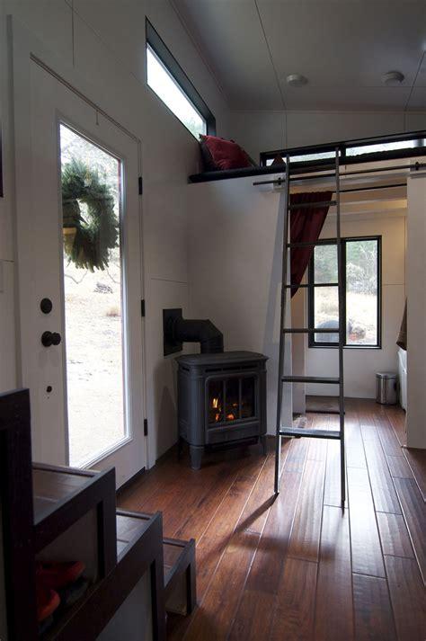 elegant minimalist tiny house  wheels  staircase