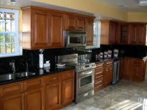 golden oak kitchen cabinets with black countertops granite with medium warm cherry