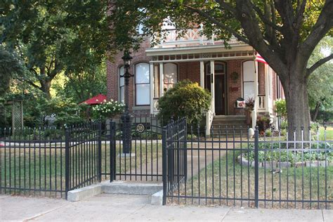 fencing front yard black wrought iron metal front yard fence with small gate and decorative top lattice on grey